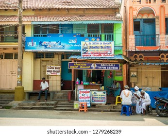 Chikmagalur, kamagaluru, India- December 19, 2018 : South indian men drinking tea/coffee outside street food stall in traditional attire