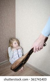 Child Abuse with abusive parent father, girl standing in the corner punished