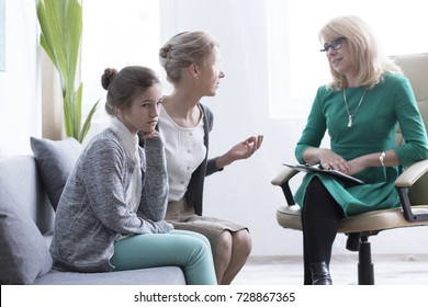 Child and adolescent mental health concept, mother of female teenager with anxiety during psychological consultation with professional therapist