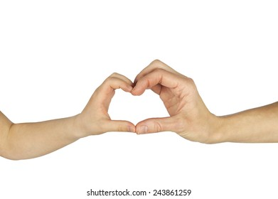 child and adult female hands forming shape of a heart