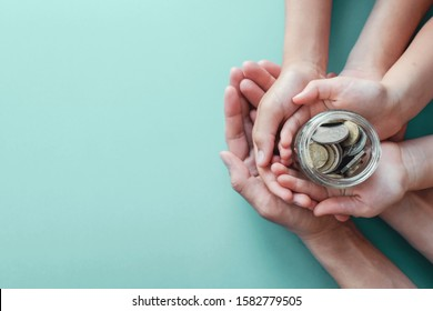 child and adult holding money jar, donation, saving, fundraising charity, family finance plan concept, Coronavirus economic stimulus rescue package, superannuation concept