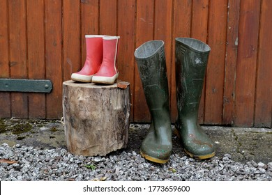 Child and adult Wellies outdoors