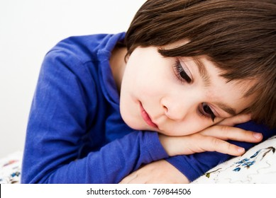 Child affected by Asperger's syndrome in the solitude of his room