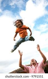 child in the air having fun with his dad