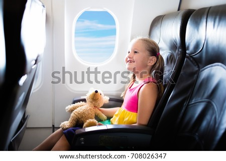 Child In Airplane Kid Air Plane Sitting Window Seat Flight Entertainment For