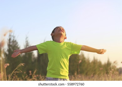 Child with arms outstretched. Freedom and happiness concept.