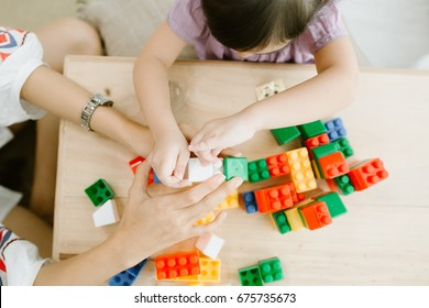 Child Asia girl playing with sorter toys