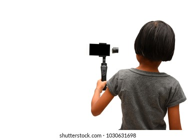 Child Asian girl holding Smartphone Gimbal Stabilizer to recording footage. Child and Technology concepts. Isolated on white background.