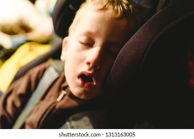 Child asleep in his extenuated car seat.