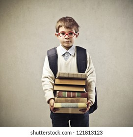 Child with a backpack holding some books