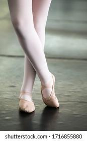 Child ballerina legs in a ballet studio class