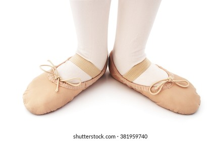 Child with ballet slipper on a isolated white background.