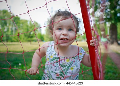 child  behind a grid