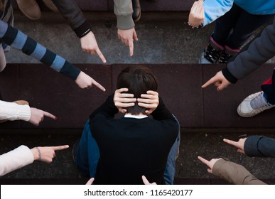 A child being bullied by a group of children. bullying scene