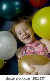 child between balloons