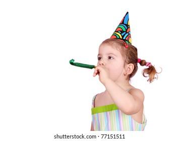 child with birthday hat on white