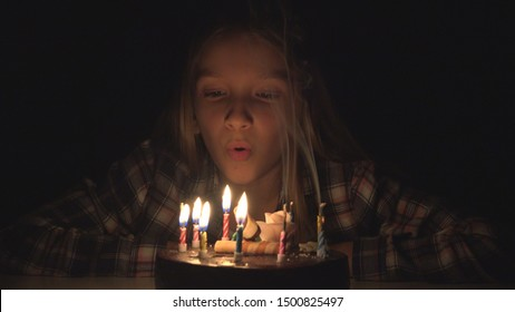 Child Birthday Party Blowing Candles in Night, Children Anniversary Celebration