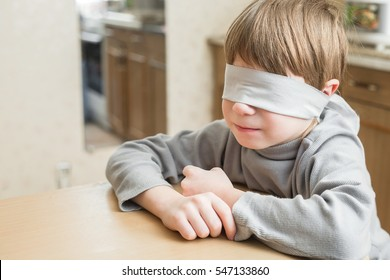 The child was blindfolded at home.