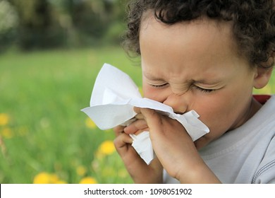 child blowing nose after catching a cold