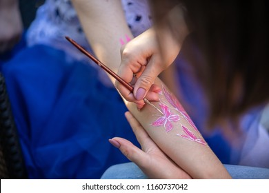 child body art. pictures on arm