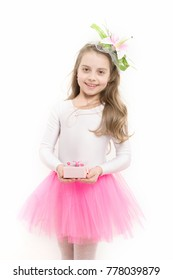 fe67270d82ad Child with box in pink skirt tutu isolated on white. Girl ballerina smile  with flower