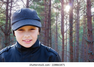 child boy backlight portrait pine forest outdoor travel scout
