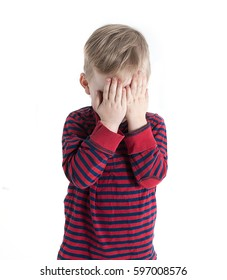 Child boy corner face with hands. Boy stay alone isolated on white background. Family violence and aggression concept - furious angry man raised punishment fist over scared or terrified.