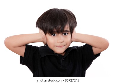 child boy covering his ears  over white background