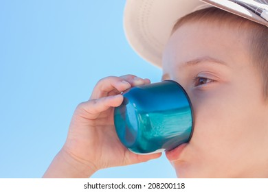 child boy drink water close up outdoor