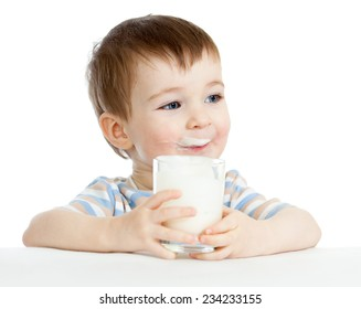 child boy drinking milk or yogurt from glass