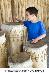 Child boy drumming traditional african drums