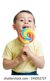 child boy eating lollipop isolated