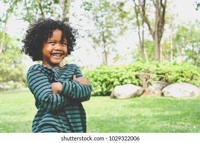 child boy happy and laugh hair style afro relax in weekend holiday lifestyle park outdoor nature background or wallpaper copy space for your text or design.