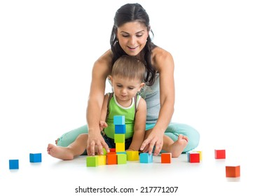 child boy and mother playing together with block toys