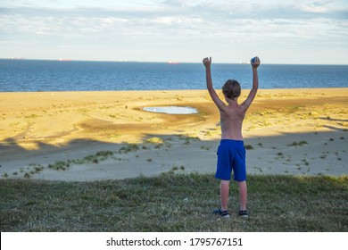 child boy over beach and sand dunes at Lowestoft Suffolk