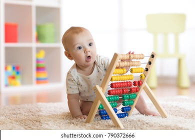 child boy playing with abacus in kindergarten or home