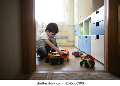 child boy playing alone in the room, loneliness and sadness