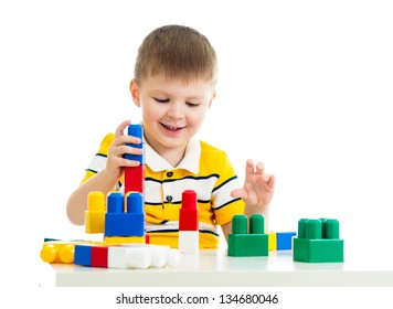 child boy playing construction set toy