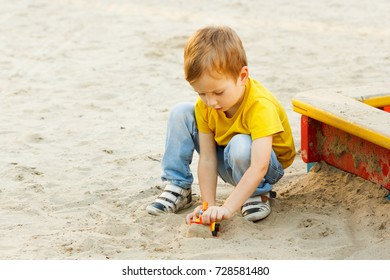 Child boy playing on playground summer cheerful activity.