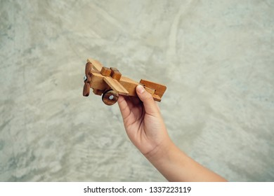 Child boy playing with toy airplane