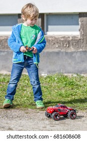 Child boy plays with rc toy car.