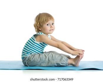 Child boy practicing yoga, stretching in exercise wearing sportswear. Kid isolated over white background