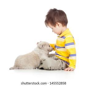 child boy with puppy dog