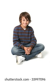 Child boy sitting. happy kid sat isolated on white background with jeans