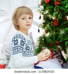 child boy in a winter sweater. Square. The concept of Christmas and New Year.