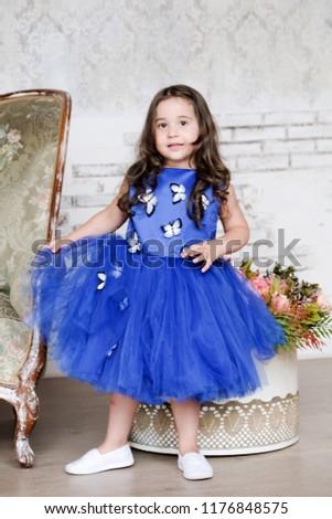c1f5e041960 Child Brunette Girl Blue Dress Posing Stock Photo (Edit Now ...