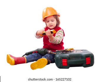 Child in builder hardhat with tools. Isolated over white