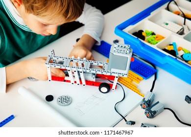 child building robot at robotic technology school lesson