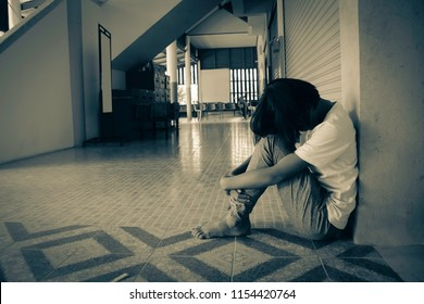 Child was bullied, kid sad and unhappy, Asian girl sitting on the school. Concept dramatic loneliness, sadness, depression, sad emotions, cry, disappointed, bully.