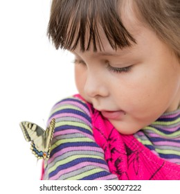 Child and butterfly. Portrait of preschooler girl with papilio machaon